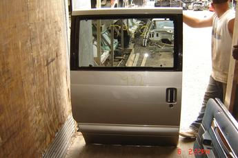 2001 Chevrolet Astro Van Right side slider door.  Good condition, 1 stone chip and small dent.  Beige exterior.  Fits years 1995 - 2005.