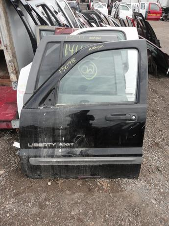 02-07 JEEP LIBERTY DOOR FROM MICHIGAN. GOOD CONDITION, SCUFFS AND SCRATCHES, RUST ON BOTTOM EDGE. #13098