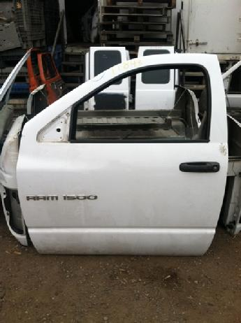 2002 2003 2004 2005 2006 2007 2008 2009 Dodge manual complete standard cab door.  Good overall condition, a dent along the top edge ofthe door.  Inventory #11843.