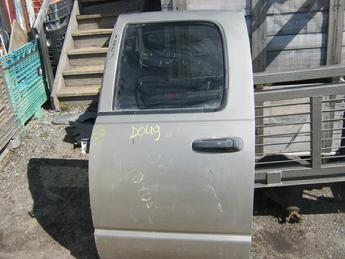 2002 2003 2004 2005 2006 2007 2008 2009 Dodge drivers side rear manual crew cab door.  Door has a dent below the door handle and some scratches in the paint.  Reference inventory #10887 when inquiring.
