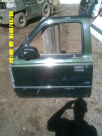 1998 1999 2000 2001 2002 2003 2004 2005 2006 2007 FORD RANGER DOOR. GOOD CONDITION, LOTS OF LIGHT SCRATCHED AND SCUFFS, PAINT IS PEELING AND FLAKING OFF THE FRONT EDGE. INVENTORY #12469