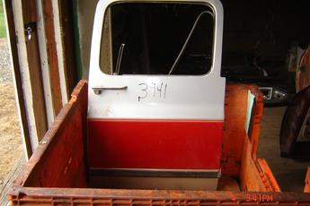 73 - 91 Chevrolet Suburban Right Side OEM Secondary Door.  Silver & red in color.