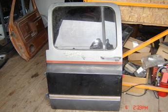 73 - 91 Chevrolet Suburban Left Side OEM Secondary Door.  Excellent condition.  Black & grey in color.