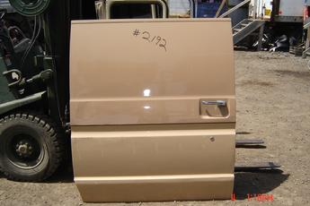 75 - 91 Ford Van Slider Side Door.  Solid, no windows, good condition, some dings.  Tan exterior, no interior panel.