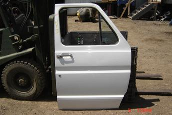 73 - 91 Ford Full Size Van Right side manual door.  Excellent condition, white exterior.