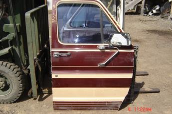 75 - 91 Ford Fullsize Van Right side manual Door.  Door is in great shape.  Manual crank does work.  Exterior is brown & tan.