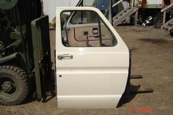 75 - 91 Ford Fullsize Van Right side Manual Door.  Door has a couple of small dings on body line. White exterior, grey interior.