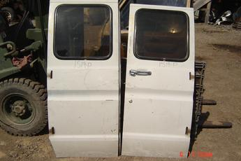 75 - 91 Ford Van Manual Side Cargo Doors.  Doors are in excellent condition.  Originally brown, painted white, interior is brown, no interior panels.