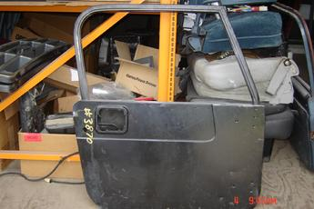 1987 1988 1989 1990 1991 1992 1993 1994 1995 1996 Jeep Wrangler YJ door shell.  Dent by outside handle, door in black primer.