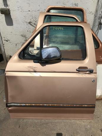 1992 1993 1994 1995 1996 1997 FORD LF DOOR. POWER WINDOW. FRONT EDGE IS BENT. RUST FREE. #14494
