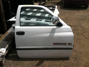 1994 1995 1996 1997 1998 1999 2000 2001 Dodge passenger side complete power door with glass & hardware.  Some paint chips and scratches through out face of door.  Inventory #11865.