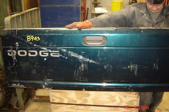 1994 1995 1996 1997 1998 1999 2000 2001 Dodge tailgate complete with hardware.  Good condition, 1 dent on top, 1 small dent on bottom, green,