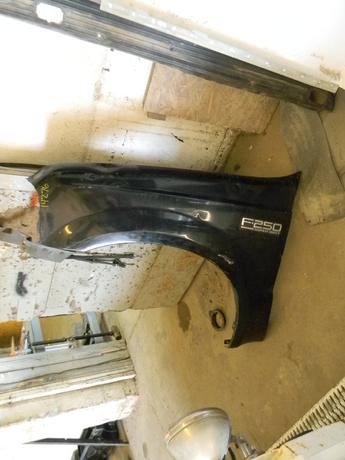 1999 2000 2001 2002 2003 2004 2005 2006 2007 FORD SUPER DUTY DRIVERS SIDE FRONT FENDER. OKAY CONDITION- BEAT UP, MULPITLE CREASES, DINGS, AND DENTS. RUST FREE. #14276