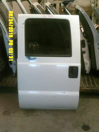 1999 2000 2001 2002 2003 2004 2005 2006 2007 FORD SUPER DUTY CREW CAB DOOR. GOOD CONDITION, SCUFFS AND SCRATCHES, SCATTERED DINGS AND WAVES IN LOWER. INVENTORY #12799