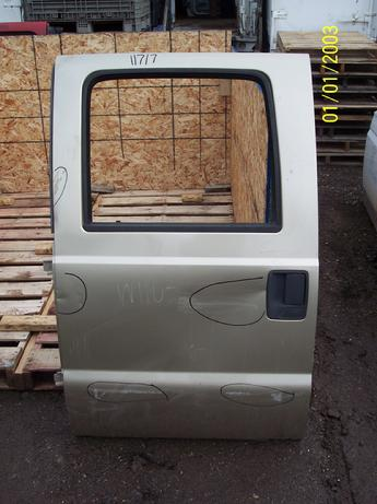1999 2000 2001 2002 2003 2004 2005 2006 2007 2008 2009 2010 Ford Superduty drivers side crew cab power door.  Large dent by door handle, lot of dings, scratches & scuffs in paint.  Inventory #11717.