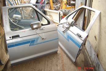 1983 1984 1985 1986 1987 1988 1989 1990 1991 1992 Ford Ranger Right Side OEM Power Door.  Very nice condition, silver with blue sticker kit.